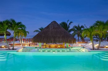Couples Negril nighttime pool
